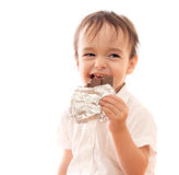 Happy little boy with bar of chocolate in his hand Stock Image
