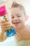 Happy little boy bathing in bathtub. At home royalty free stock images