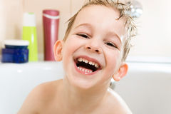 Happy little boy bathing in bathtub Stock Photography