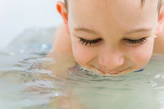 Happy little boy bathing in bathtub Royalty Free Stock Photos