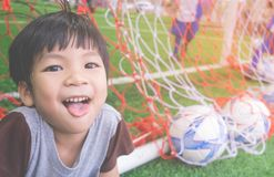 Happy Little boy behind the Goal in soccer training. Field Royalty Free Stock Images