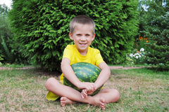Happy little boy with a big watermelon Stock Images