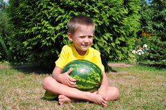 Happy little boy with a big watermelon Stock Photos