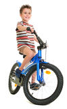 Happy little boy on bike. Isolated on white Royalty Free Stock Photography