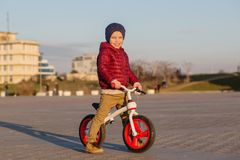 A happy little boy on a bike ride stock images