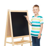 Happy little boy with blackboard and chalk Royalty Free Stock Photo