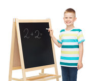 Happy little boy with blackboard and chalk Stock Photo