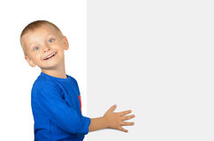 Happy little boy with blank board. Isolated on white background Royalty Free Stock Photos