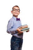 Happy little boy with books isolated on white background Royalty Free Stock Photos