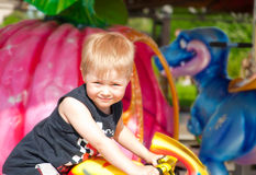 Happy little boy on the carousel Stock Photography