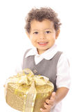 Happy little boy carrying a gift Stock Photos