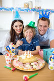 Happy little boy celebrating his birthday. In the kitchen Stock Image