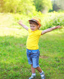 Happy little boy child having fun playing in summer Stock Photo