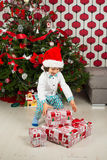 Happy little boy with Christmas gifts Royalty Free Stock Image