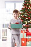 Happy little boy with christmas present Royalty Free Stock Images