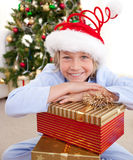 Happy little boy with Christmas presents Stock Image