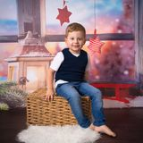 Happy little boy in christmas scenery. Happy little boy posing in christmas scenery royalty free stock images