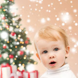Happy little boy with christmas tree and gifts Royalty Free Stock Photo
