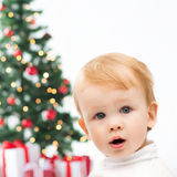 Happy little boy with christmas tree and gifts Royalty Free Stock Image