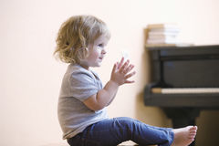 Happy Little Boy Clapping At Home Royalty Free Stock Photography