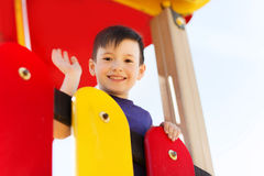 Happy little boy climbing on children playground Royalty Free Stock Photo