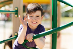 Happy little boy climbing on children playground Royalty Free Stock Image