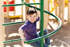 Happy little boy climbing on children playground Royalty Free Stock Images