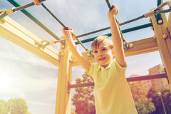 Happy little boy climbing on children playground Royalty Free Stock Photos