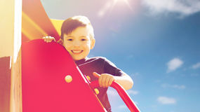 Happy little boy climbing on children playground Stock Photography