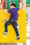 Happy little boy climbing on children playground Royalty Free Stock Photography