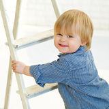 Happy little boy climbing the ladder Royalty Free Stock Images