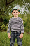 Happy little boy in a colorful blue hat Royalty Free Stock Photos