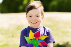 Happy little boy with colorful pinwheel at summer Royalty Free Stock Photo