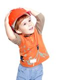 Happy little boy in the construction helmet stock photo
