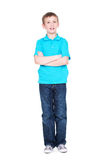 Happy little boy with crossed hands. Royalty Free Stock Image