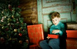 Happy little Boy decorate Christmas tree stock image