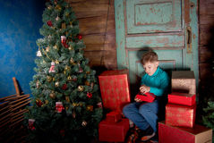 Happy little Boy decorate Christmas tree Royalty Free Stock Photography