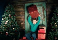Happy little Boy decorate Christmas tree Royalty Free Stock Photos