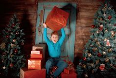 Happy little Boy decorate Christmas tree Stock Images