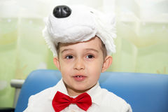 Happy little boy dressed as polar bear in New Year's holiday Royalty Free Stock Photos