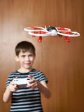 Happy little boy drives toy quadcopter drone Stock Images