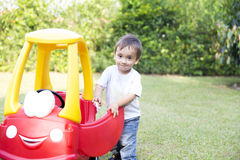 Happy Little Boy Driving His Toy Stock Images