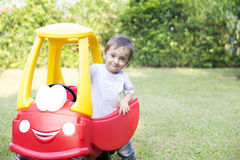 Happy Little Boy Driving His Toy Royalty Free Stock Photo