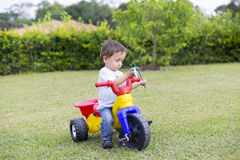 Happy Little Boy Driving His Toy Royalty Free Stock Photos