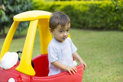 Happy Little Boy Driving His Toy Stock Photos
