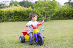 Happy Little Boy Driving His Toy Royalty Free Stock Images