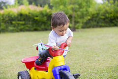 Happy Little Boy Driving His Toy Stock Photo