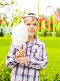 Happy little boy eating cotton candy Royalty Free Stock Photos