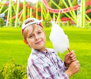 Happy little boy eating cotton candy Royalty Free Stock Photography