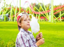 Happy little boy eating cotton candy Royalty Free Stock Image